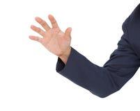 Gancho agarrador de la mano del hombre de negocios aislado en el fondo blanco Fotografía de archivo libre de regalías