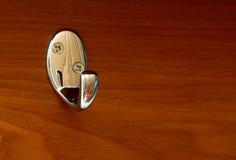 Gancho de Chrome na madeira Fotografia de Stock Royalty Free
