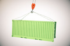 Gancho de la grúa con el cargo verde Imágenes de archivo libres de regalías