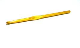 Gancho de leva de ganchillo del oro Imagenes de archivo