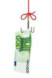 Gancho de leva y dinero de pesca Foto de archivo libre de regalías