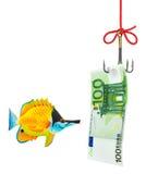 Gancho de leva y dinero de pesca Fotos de archivo
