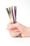 Ganchos coloridos para fazer malha Fotografia de Stock Royalty Free