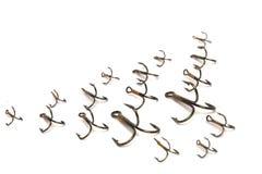 Ganchos de peixes do triplo isolados em um fundo branco Fotografia de Stock Royalty Free