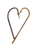 Ganchos de peixes oxidados velhos no formulário do coração Imagens de Stock
