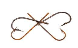 Ganchos de peixes oxidados velhos no formulário dos corações Imagem de Stock Royalty Free