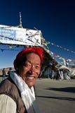 The Ganchula Mountain Pass Tibetan man Tibet. The Ganchula Mountain Pass elderly smiling Tibetan man Tibet Stock Image