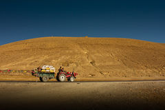 The Ganchula Mountain Pass with a tractor, Tibet Stock Photo