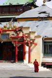 Gandan Monastery. Young monk leaving a temple in the Gandan Monastery complex in Ulaanbaatar, Mongolia stock photo