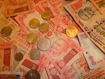 Gandhi e moeda indiana Foto de Stock