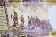 Gandhi March banknote. An Indian banknote showing the country's leader Mahatma Gandhi leading a line of his fellow countrymen and women on a journey Royalty Free Stock Photos