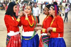 Nepali girls in traditional costume. Gandhinagar, India - March 9, 2018: Group of Sikkim girls from Nepalese community dressed in traditional attire having fun royalty free stock image