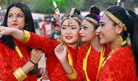 Nepali girls in traditional costume. Gandhinagar, India - March 9, 2018: Group of Sikkim girls from Nepalese community dressed in traditional attire having fun royalty free stock images