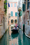 Gandoler on a black gondola driving in Crand canal Royalty Free Stock Photography