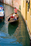 Gandoler on a black gondola driving in Crand canal Stock Image