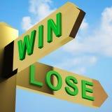 Gane o pierda las direcciones en un poste indicador Foto de archivo libre de regalías