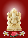 Ganesh. Made of ivory with floral decorations Royalty Free Stock Image