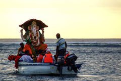 Ganesh Chaturthi, Indian Ocean. Men going to immerse the statue of Ganesh durin the Chaturthi in Mauritius royalty free stock photography