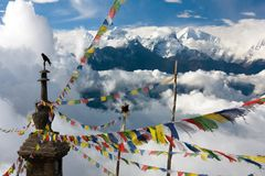 Ganesh Himal with stupa and prayer flags. View from Langtang to Ganesh Himal with stupa and prayer flags and beautiful clouds - Nepal Stock Photo