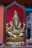 Ganesh Indian God Elephant Buddha. Golden Idol of Hindu Lord Ganesh Blessing Everyone stock photography