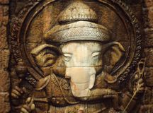 Ganesh. Statues against a brick wall background Royalty Free Stock Photo