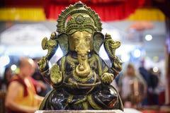 Ganesha, индусское божество с хоботком и 4 оружиями Стоковое фото RF