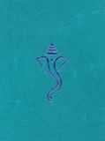 Ganesha Art. A handmade turquoise invitation paper with the Hindu God Ganesha engraved in blue on it Stock Image