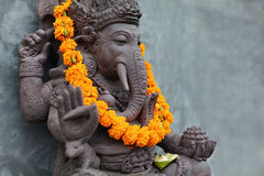 Ganesha with balinese Barong masks, flowers necklace and ceremonial offering Royalty Free Stock Image