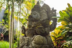 Ganesha coverd by moss in the park.  stock images