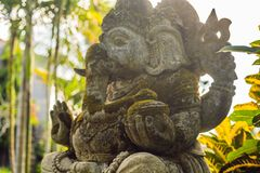 Ganesha coverd by moss in the park.  royalty free stock photography