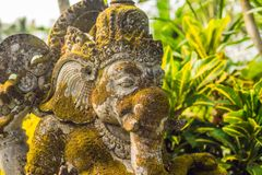 Ganesha coverd by moss in the park.  stock photo