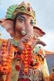Ganesha Ganesh Elephant God temple flowersflower offering temple Ganesh gold statue - Lord of good omen also known as Ganapati Stock Images