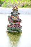 Ganesha in garden. God of success royalty free stock image