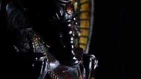 Ganesha, Hindu deity figure, turning on black background
