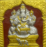 Ganesha Hindu god. Although he is known by many attributes, Ganesha`s elephant head makes him easy to identify. Ganesha is widely revered as the remover of stock photo