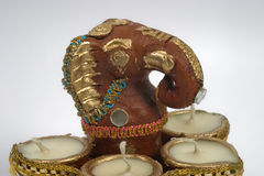 Ganesha with lamps. Decorated sculpture of Ganesha with lamps, Hindu God of Success and prosperity Stock Photo