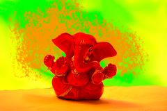 Ganesha - Red Ganapathi in vibrant backgorund. For greetings and wallpapers Royalty Free Stock Image