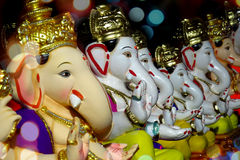 Ganesha on sale. Ganesha Idols with different moods and poses for sale during Ganesha festival in India Stock Image