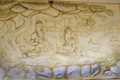 Ganesha Scripting Mahabharata. Wall panel at Shaktinagara Gopalakrishna Temple depicting Maharishi  Vyas dictating story of epic Mahabhatata to Ganesha Royalty Free Stock Images