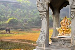 Ganesha shrine with elephant in background Stock Photography