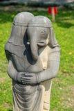 A ganesha statue hugging stock photo