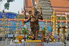 Ganesha statue and offerings. Statue of god ganesha and offerings in wat arun areal in bangkok, thailand Stock Photo
