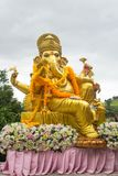 Ganesha statue in sitting action with many decoration stock photography