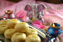 Ganesha and sweet Stock Image