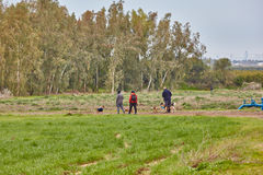 Ganey Aviv - 02 December 2016: Three friends walk with dogs in t Stock Photo