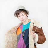 Gang boy. Teenage boy pimp in gang style with coat and hat royalty free stock images