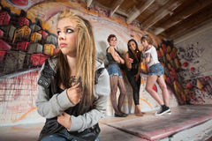 Gang Bullying Teen. Insecure European teenager being bullied by female gang Royalty Free Stock Photo
