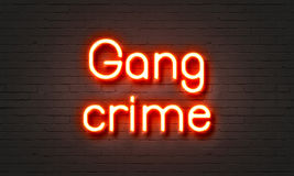 Gang crime neon sign on brick wall background. Gang crime neon sign on brick wall background Stock Photos