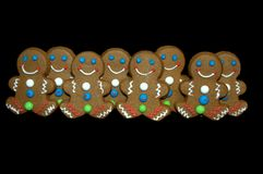 The Gang. Eight gingerbread men lined up Royalty Free Stock Image