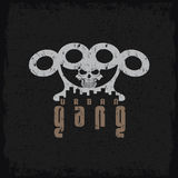 Gang grunge emblem with brass knuckles and skull. Urban gang grunge emblem with brass knuckles and skull Royalty Free Stock Photo